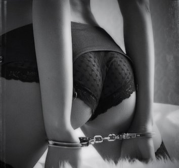 wife handcuffs on bed