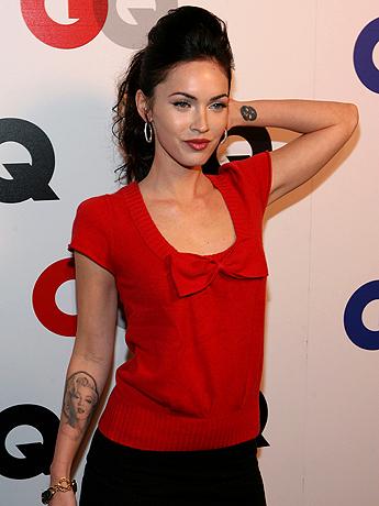 Megan Fox cute thumbs is getting her tattoo of tragic icon Marilyn Monroe