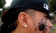 spider face tattoo