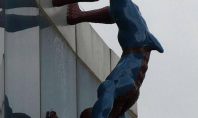 erect spiderman sculpture