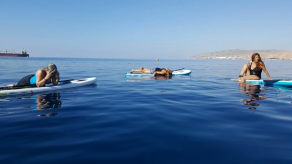 paddleboard yoga in the red sea