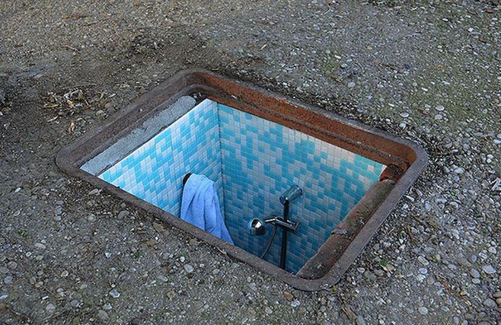 man hole art